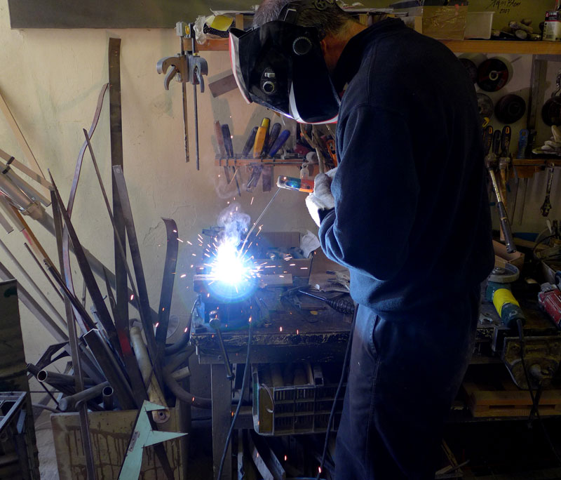 Daniel welding the stacked steel – counter weights